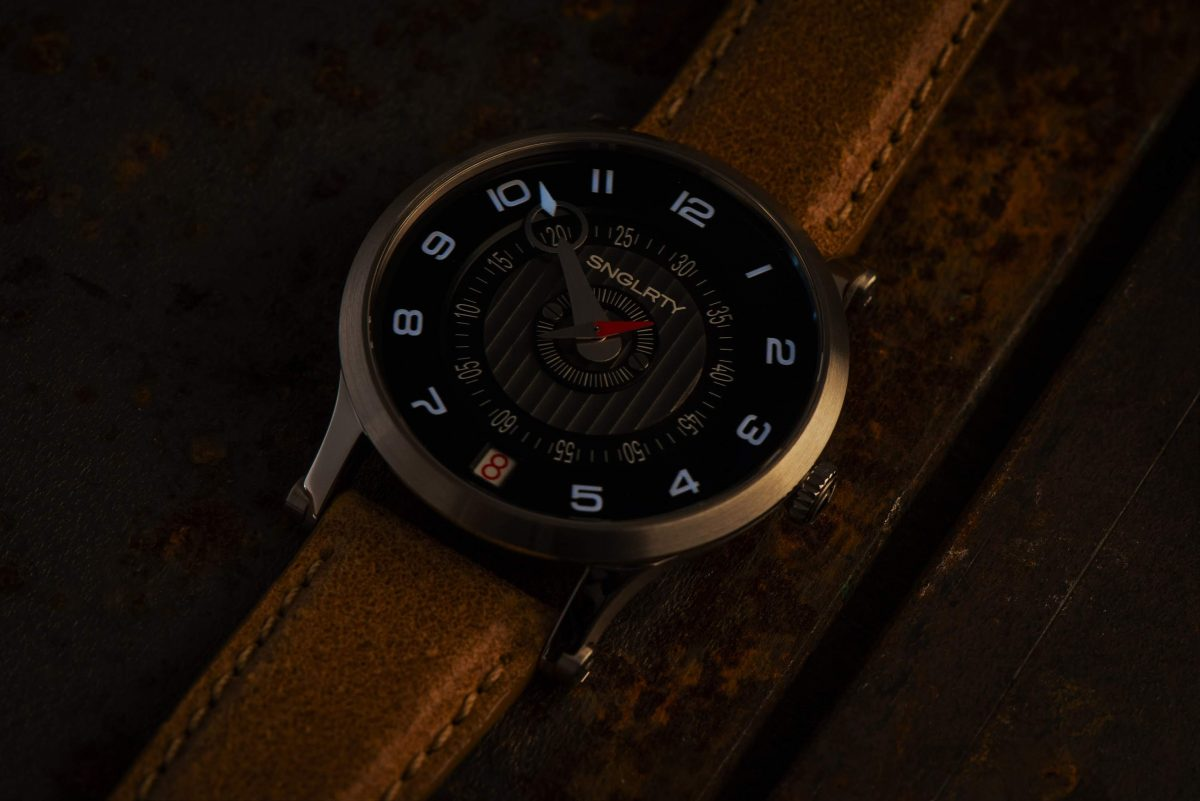 SNGLRTY OHI4 in a Semi-Light Illustrating the Luminous Dial and Hand