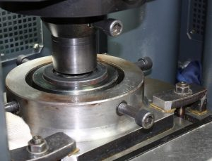 Cold working the steel produces microstrains in the workpiece, particularly near the surface. Using austenitic stainless steel allows these strains to be released easily.